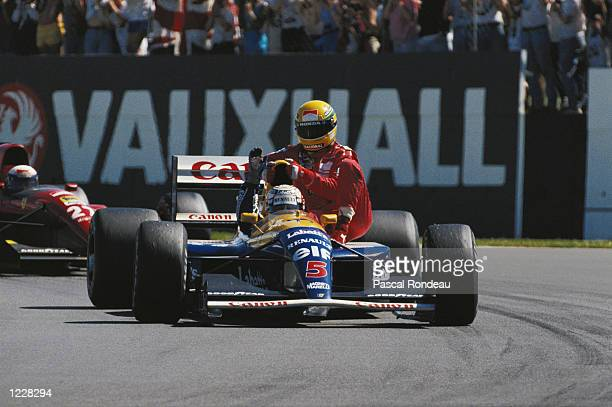Williams Renault driver Nigel Mansell of Great Britain gives McLaren Honda driver Ayrton Senna of Brazil a lift home after the British Grand Prix at...