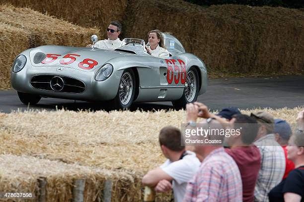 Williams reserve driver Susie Wolff driving a Mercedes Benz 300SLR at Goodwood on June 26 2015 in Chichester England