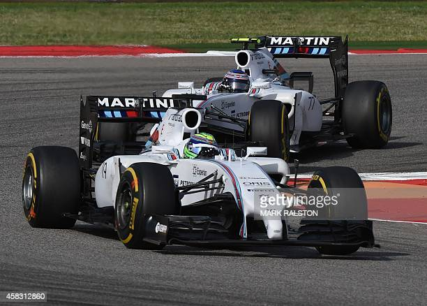 Williams Team driver Felipe Massa of Brazil leads teammate Valtteri Bottas of Finland in the United States Formula One Grand Prix at the Circuit of...