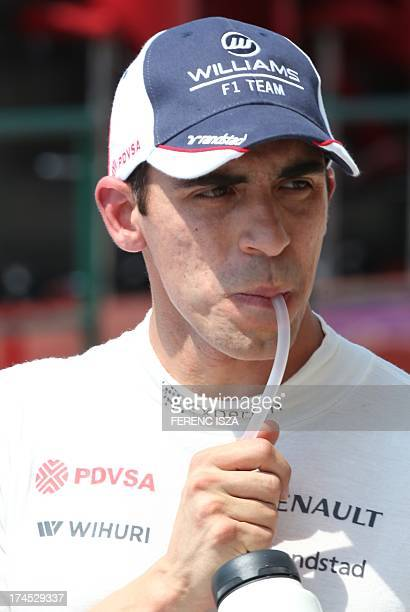 William's Venezuelan driver Pastor Maldonado drinks in the pits during the third practice session at the Hungaroring circuit in Budapest on July 27...