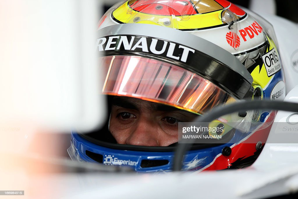 William's Venezuelan driver Pastor Maldonado sits in the pits on April 19, 2013 during the second practice session at the Bahrain International Circuit in Manama ahead of the Bahrain Formula One Grand Prix. AFP PHOTO / MARWAN NAAMANI