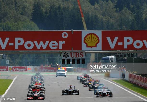 William's Venezuelan driver Pastor Maldonado takes off before the green lights after the start of racing at the SpaFrancorchamps circuit on September...