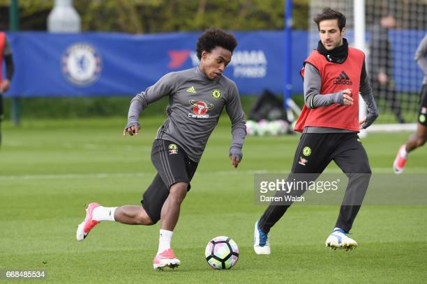 Willian and Cesc Fabregas of Chelsea during a training session at Chelsea Training Ground on April 14 2017 in Cobham England
