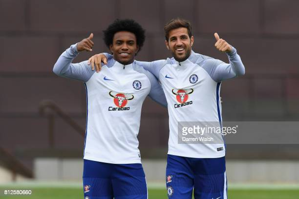 Willian and Cesc Fabregas of Chelsea during a training session at Chelsea Training Ground on July 11 2017 in Cobham England