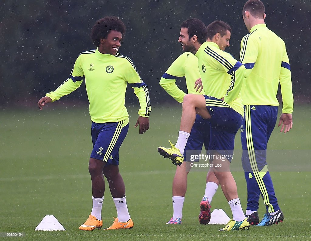 Willian and Cesc Fabregas warm up during the Chelsea Training Session at Chelsea Training Ground on September 29, 2014 in Cobham, England.