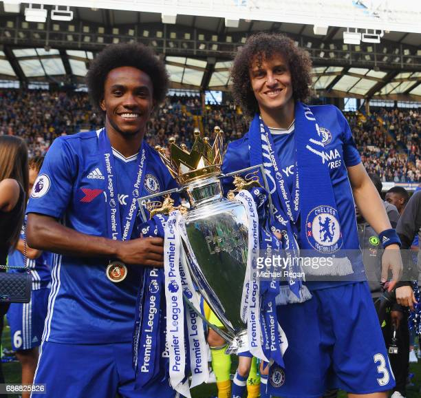 Willian and david Luiz of Chelsea pose with the Premier League trophy after the Premier League match between Chelsea and Sunderland at Stamford...