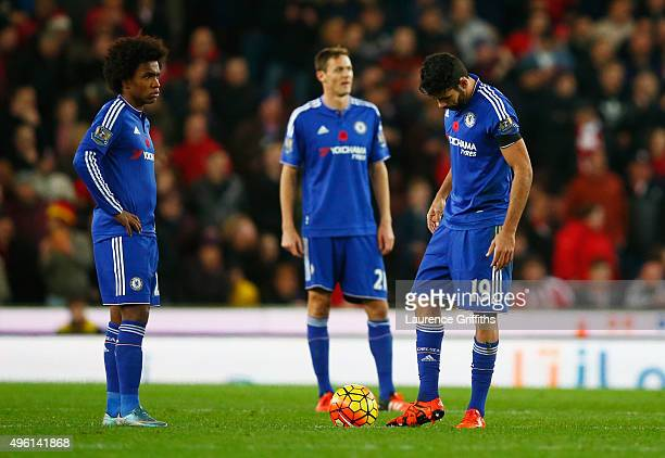 Willian and Diego Costa of Chelsea show their dejection after conceding the first goal to Stoke City during the Barclays Premier League match between...