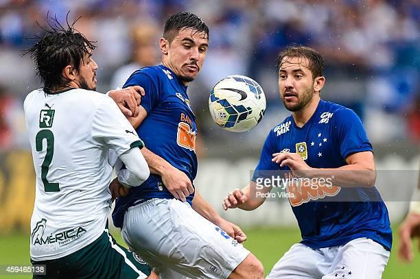 Willian and Everton Ribeiro of Cruzeiro and Tiago Real of Goias battle for the ball during a match between Cruzeiro and Goias as part of Brasileirao...