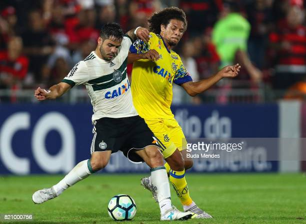 Willian Arao of Flamengo struggles for the ball with Henrique Almeida of Coritiba during a match between Flamengo and Coritiba as part of Brasileirao...