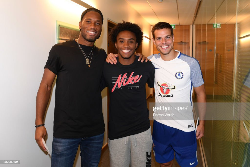 Willian, Cesar Azpilicueta of Chelsea with Ex Chelsea player Didier Drogba after a training session at Chelsea Training Ground on August 23, 2017 in Cobham, England.