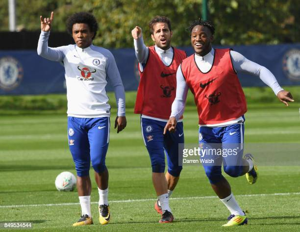 Willian Cesc Fabregas and Michy Batshuayi of Chelsea during a training session at Chelsea Training Ground on September 19 2017 in Cobham England