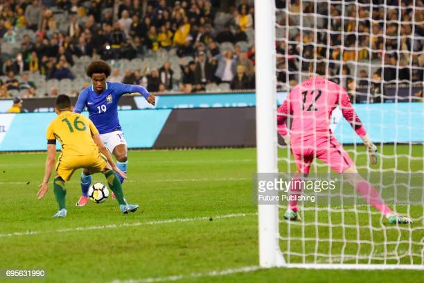 Willian competes with Aziz Behich during play as Brazil plays Australia in the Chevrolet Brasil Global Tour 2017 on June 13 2017 in Melbourne...