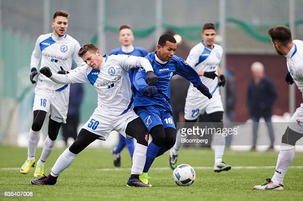 Willian Henrique dos Santos right of Slovakian football club FC STK Samorin controls the ball during a friendly soccer match against Hungarian...