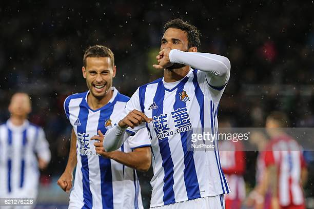 Willian Jose of Real Sociedad celebrates with teammates after scoring during the Spanish league football match between Real Sociedad and Atletico...