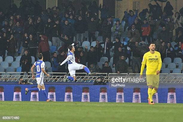 Willian Jose of Real Sociedad celebrates with teammates after scoring during the Spanish Kings Cup round of 8 finals first leg football match between...