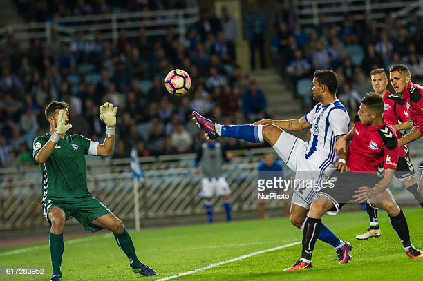 Willian Jose of Real Sociedad duels for the ball with Vigaray and Fernando Pacheco of Alaves during the Spanish league football match between Real...