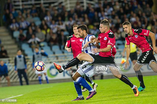 Willian Jose of Real Sociedad duels for the ball with Vigaray of Alaves during the Spanish league football match between Real Sociedad and Betis at...
