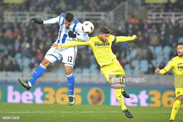 Willian Jose of Real Sociedad vies with Musacchio of Villarreal during the Spanish Kings Cup round of 8 finals first leg football match between Real...
