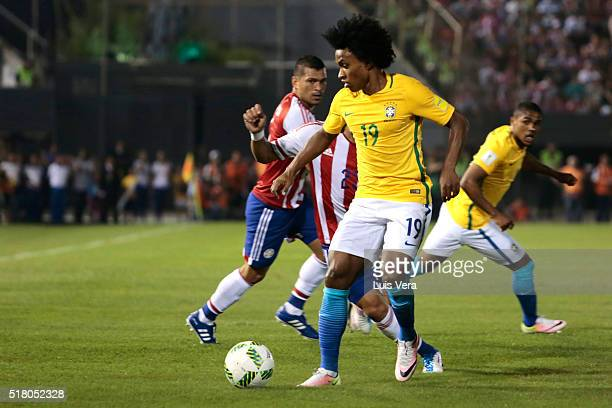 Willian of Brasil tries to control the ball during a match between Paraguay and Brazil as part of FIFA 2018 World Cup Qualifiers at Defensores del...