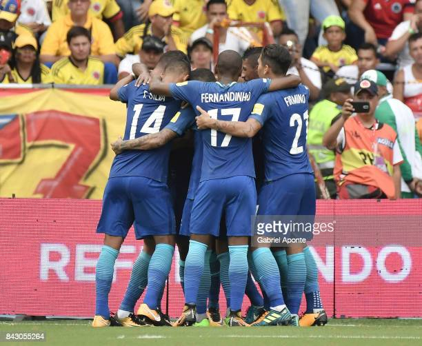 Willian of Brazil celebrates with teammates after scoring the opening goal during a match between Colombia and Brazil as part of FIFA 2018 World Cup...