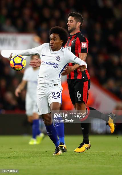 Willian of Chelsea and Andrew Surman of AFC Bournemouth battle for possession during the Premier League match between AFC Bournemouth and Chelsea at...