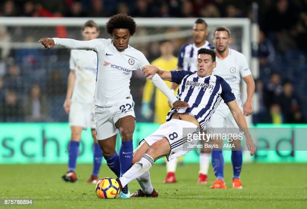 Willian of Chelsea and Gareth Barry of West Bromwich Albion during the Premier League match between West Bromwich Albion and Chelsea at The Hawthorns...