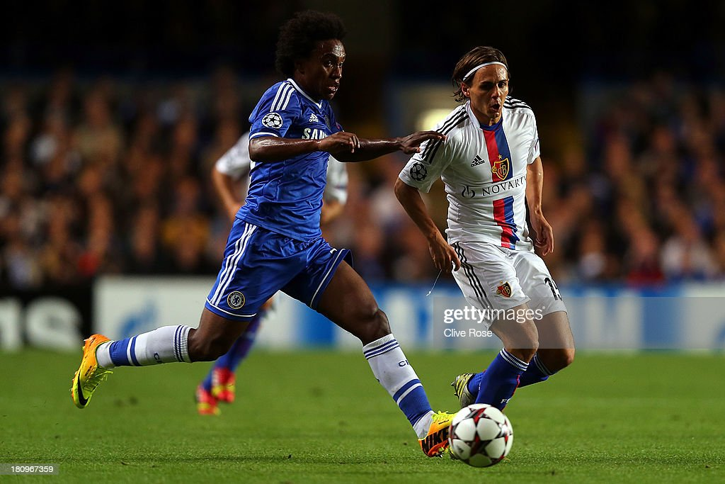 <a gi-track='captionPersonalityLinkClicked' href=/galleries/search?phrase=Willian+-+Soccer+Player+for+Chelsea+and+Brazil&family=editorial&specificpeople=9886576 ng-click='$event.stopPropagation()'>Willian</a> of Chelsea and Kay Voser of FC Basel battle for the ball during the UEFA Champions League Group E Match between Chelsea and FC Basel at Stamford Bridge on September 18, 2013 in London, England.