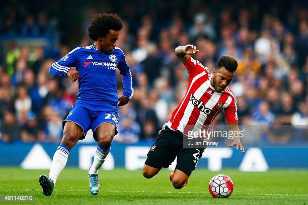 Willian of Chelsea and Ryan Bertrand of Southampton compete for the ball during the Barclays Premier League match between Chelsea and Southampton at...