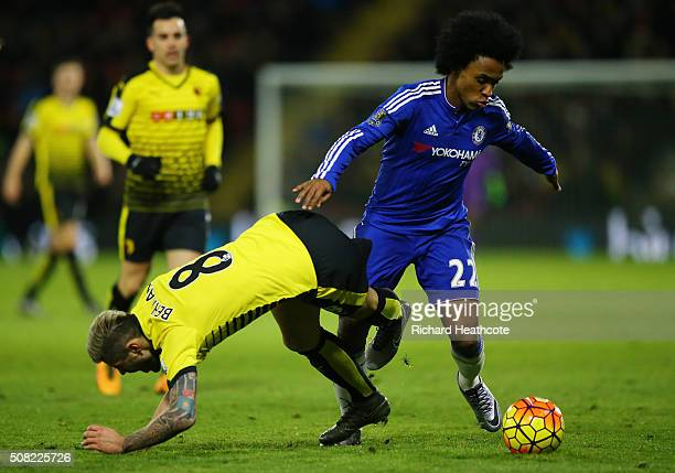 Willian of Chelsea and Valon Behrami of Watford battle for the ball during the Barclays Premier League match between Watford and Chelsea at Vicarage...