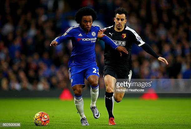 Willian of Chelsea battles for the ball with Jose Manuel Jurado of Watford during the Barclays Premier League match between Chelsea and Watford at...