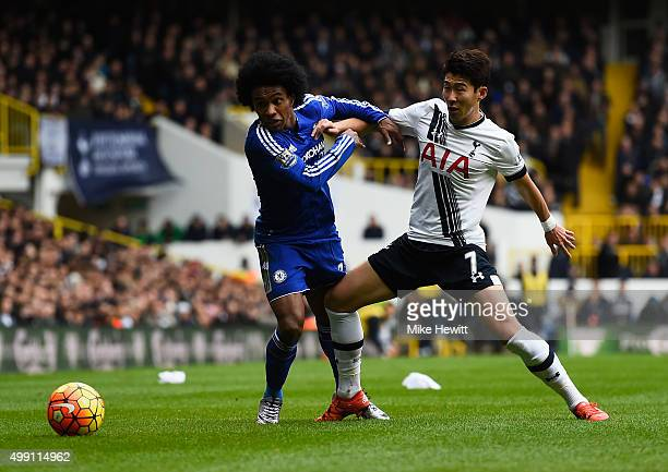 Willian of Chelsea battles with Son HeungMin of Tottenham Hotspur during the Barclays Premier League match between Tottenham Hotspur and Chelsea at...