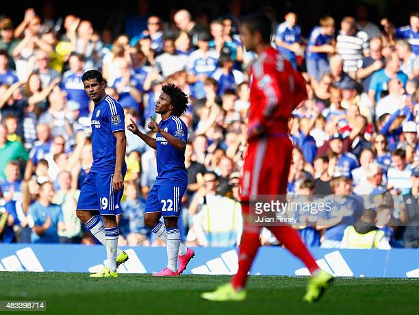 Willian of Chelsea celebrates his team's second goal scored by Federico Fernandez of Swansea City during the Barclays Premier League match between...