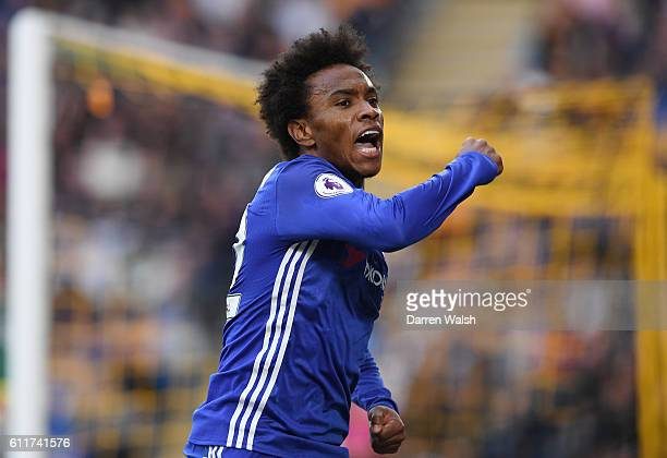 Willian of Chelsea celebrates scoring his sides first goal during the Premier League match between Hull City and Chelsea at KCOM Stadium on October 1...