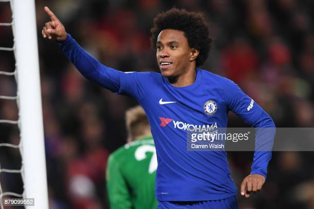 Willian of Chelsea celebrates scoring his sides first goal during the Premier League match between Liverpool and Chelsea at Anfield on November 25...