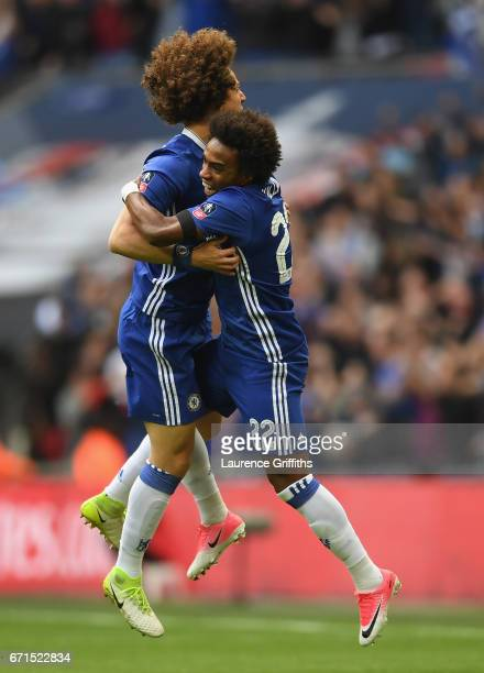 Willian of Chelsea celebrates scoring his sides first goal with David Luiz of Chelsea during The Emirates FA Cup SemiFinal between Chelsea and...