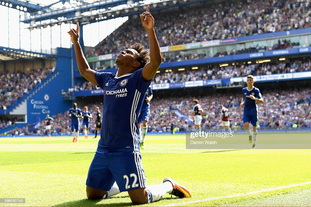 Willian of Chelsea celebrates scoring his sides second goal during the Premier League match between Chelsea and Burnley at Stamford Bridge on August...
