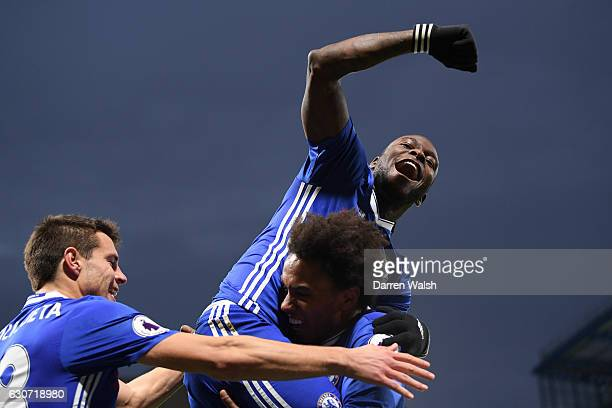 Willian of Chelsea celebrates scoring his side's second goal with his team mate Victor Moses and Cesar Azpilicueta during the Premier League match...