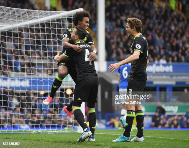Willian of Chelsea celebrates scoring his sides third goal with Cesc Fabregas of Chelsea and Marcos Alonso of Chelsea during the Premier League match...