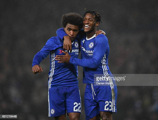 Willian of Chelsea celebrates scoring his sides third goal with Michy Batshuayi of Chelsea during The Emirates FA Cup Third Round match between...