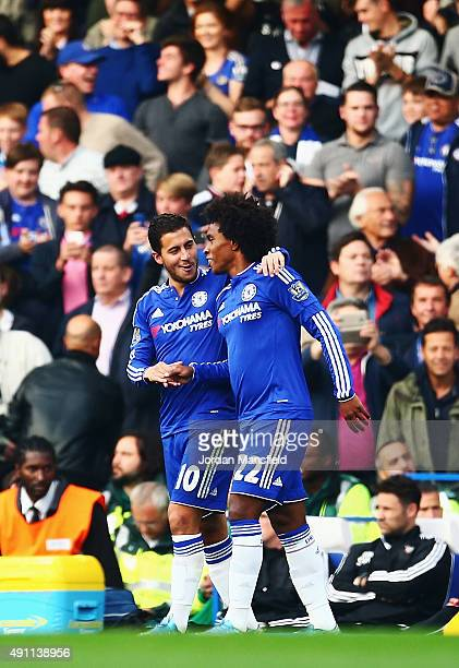 Willian of Chelsea celebrates scoring his team's first goal with his team mate Eden Hazard during the Barclays Premier League match between Chelsea...