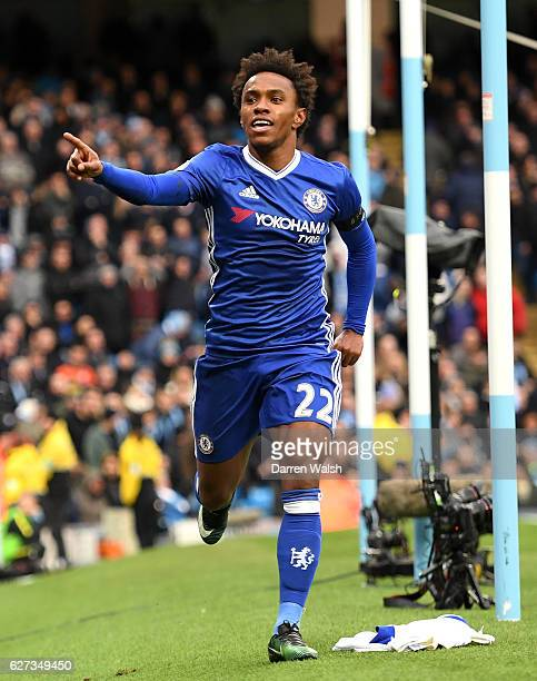 Willian of Chelsea celebrates scoring his team's second goal during the Premier League match between Manchester City and Chelsea at Etihad Stadium on...