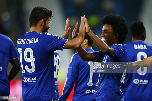 Willian of Chelsea celebrates scoring his teams second goal with Diego Costa during the UEFA Champions League Group G match between Maccabi TelAviv...