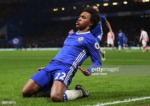 Willian of Chelsea celebrates scoring his team's third goal during the Premier League match between Chelsea and Stoke City at Stamford Bridge on...