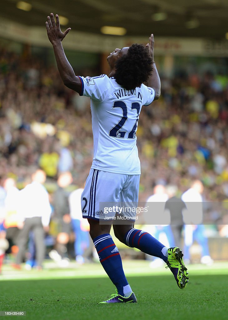 <a gi-track='captionPersonalityLinkClicked' href=/galleries/search?phrase=Willian+-+Soccer+Player+for+Chelsea+and+Brazil&family=editorial&specificpeople=9886576 ng-click='$event.stopPropagation()'>Willian</a> of Chelsea celebrates scoring their third goal during the Barclays Premier League match between Norwich City and Chelsea at Carrow Road on October 6, 2013 in Norwich, England.