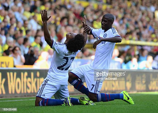 Willian of Chelsea celebrates scoring their third goal with Ramires of Chelsea during the Barclays Premier League match between Norwich City and...