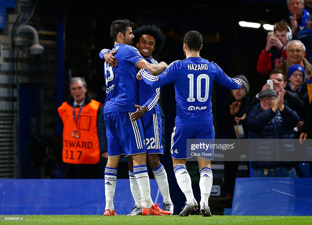 Willian of Chelsea celebrates with Diego Costa and Eden Hazard of Chelsea as he scores their second goal during the UEFA Champions League Group G...