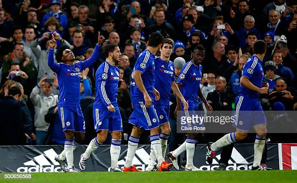 Willian of Chelsea celebrates with team mates after scoring their second goal during the UEFA Champions League Group G match between Chelsea FC and...