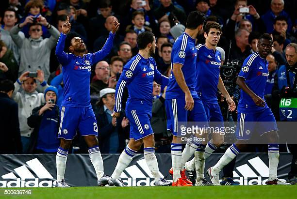 Willian of Chelsea celebrates with team mates as he scores their second goal during the UEFA Champions League Group G match between Chelsea FC and FC...