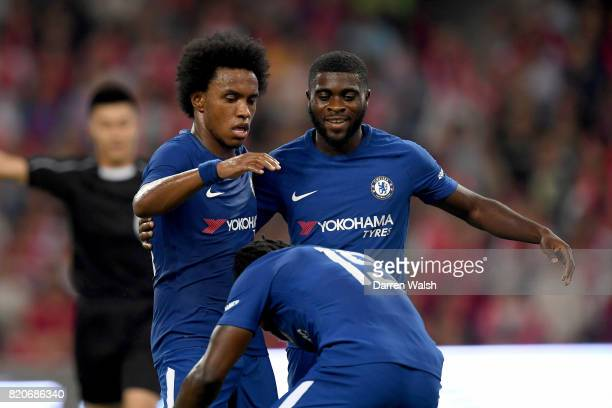Willian of Chelsea celebrates with teammates Jeremie Boga and Victor Moses after scoring the opening goal during the PreSeason Friendly match between...