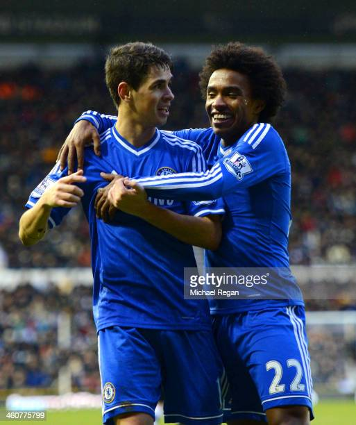 Willian of Chelsea congratulates Oscar of Chelsea on scoring their second goal during the Budweiser FA Cup Third Round match between Derby County and...